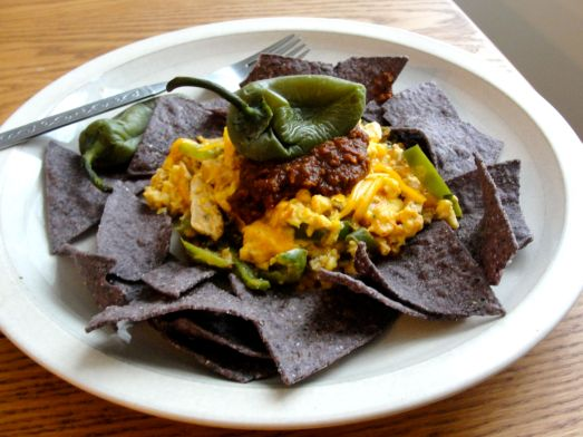 Chicken and Egg Breakfast Nachos with pasilla salsa and jalapenos.