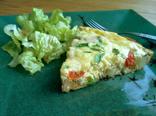 Vegetable frittata and romaine lettuce with oil and vinegar.