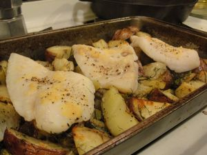 Pangasius fillets baked atop roasted fennel and potatoes