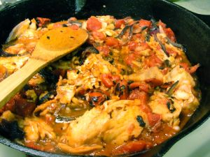 Alaskan cod with tomatoes and onion