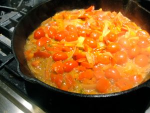 Cherry tomatoes cooking down for Tomato Coconut Curry.