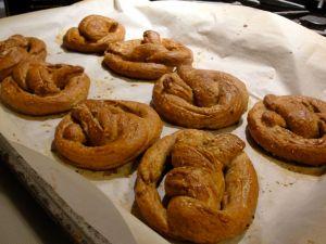 Pretzels baked on parchment paper.