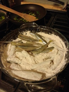 Coat the moist smelts with flour seasoned with smoked paprika, cayenne, crushed mexican oregano, salt, and pepper.