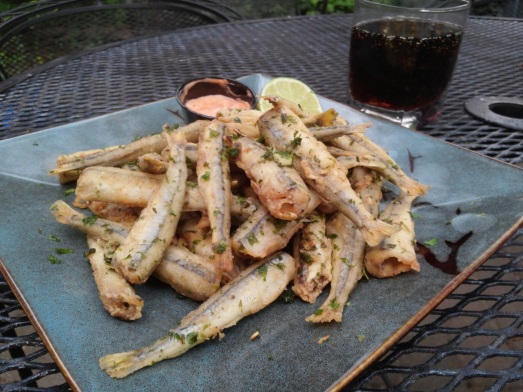 Friend smelts, tossed with garlic and cilantro leaf.