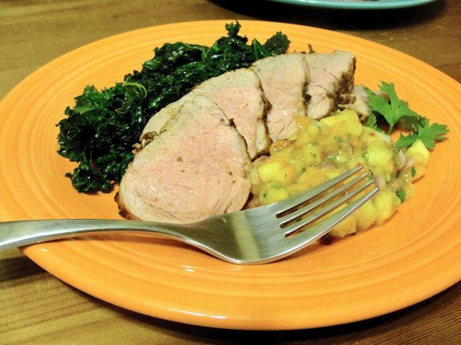 Chipotle Pork Tenderloin with Fresh Peach Salsa and sautéed kale greens.