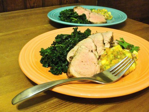 Chipotle Pork Tenderloin with Peach Salsa and Sautéed Kale.