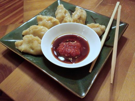 Steamed Dumplings with soy and chili garlic sauces.