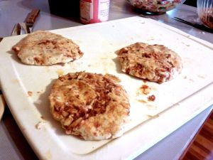 Preparing refried bean and cheese pupusas.