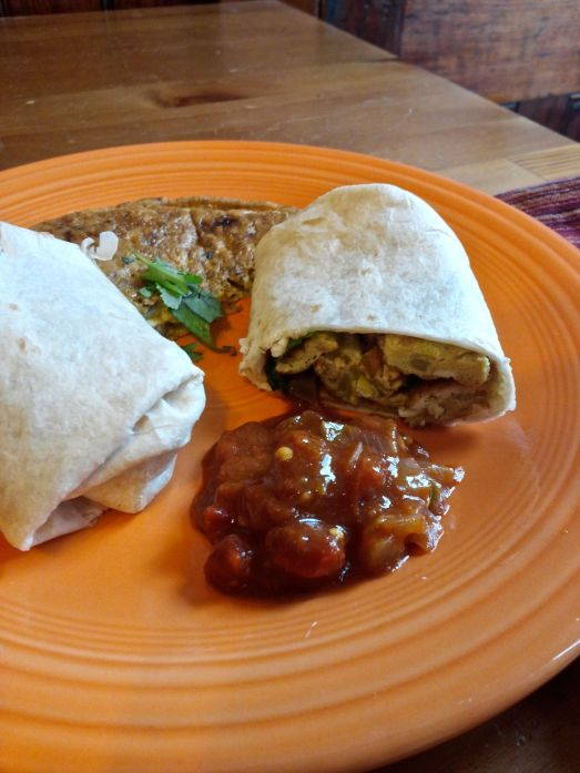 Indian omelette breakfast burrito served with curry salsa.