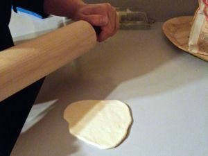 Rolling out dough for steamed bao.