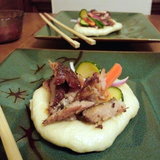 Gua bao with five spice pork ribs and pickled vegetables.