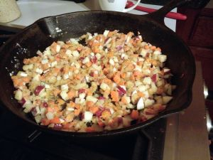 Sautéing vegetables for pie filling.