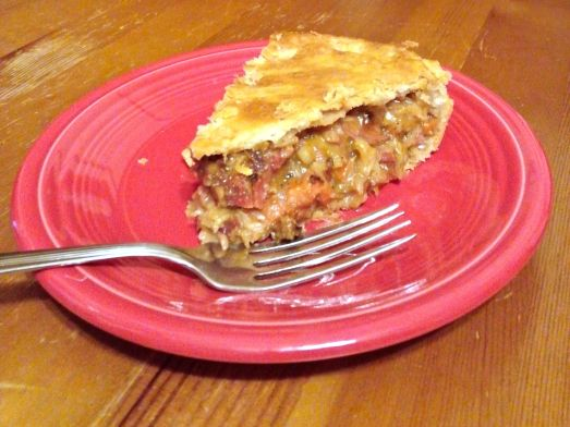 A slice of corned beef and cabbage pie.