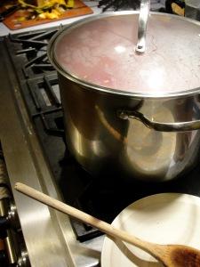 Simmer the pork, covered.