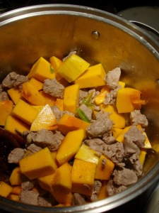 Add cubed squash to pork mixture.